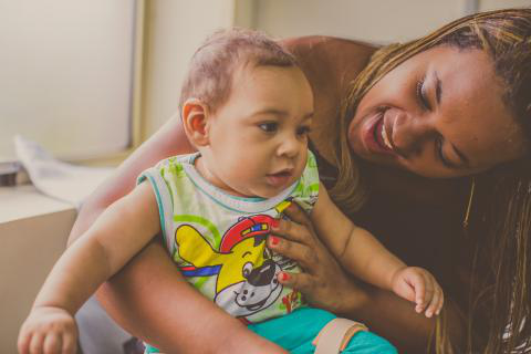 On 9 August 2016 in Recife, Brazil, Germana Soares, Founder and President of 'União de Mães de Anjos'  plays with her 8-month old boy, Guilherme, in a therapy center in Recife.