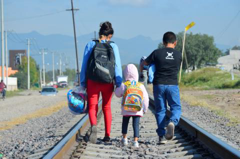 On 10 December 2014 outside of La Casa del Migrante, a catholic shelter that supports migrants near the Lechería Train Station, in the municipality of Tultitlan, State of Mexico, Maria [NAME CHANGED], 16 (on right), from Honduras travels north with her younger siblings, expecting to cross the border to the United States to reunite with her family.