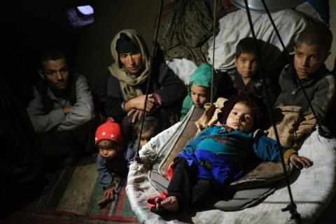On 21 November 2019, Hanifa and her husband Nabih and five of their six children sit on the floor of their one-room house in Shayadee camp for internally displaced people near Herat in Afghanistan.