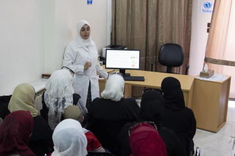 A 联合国儿童基金会-supported health worker who delivers awareness sessions on infant and young child feeding practices in Damascus.