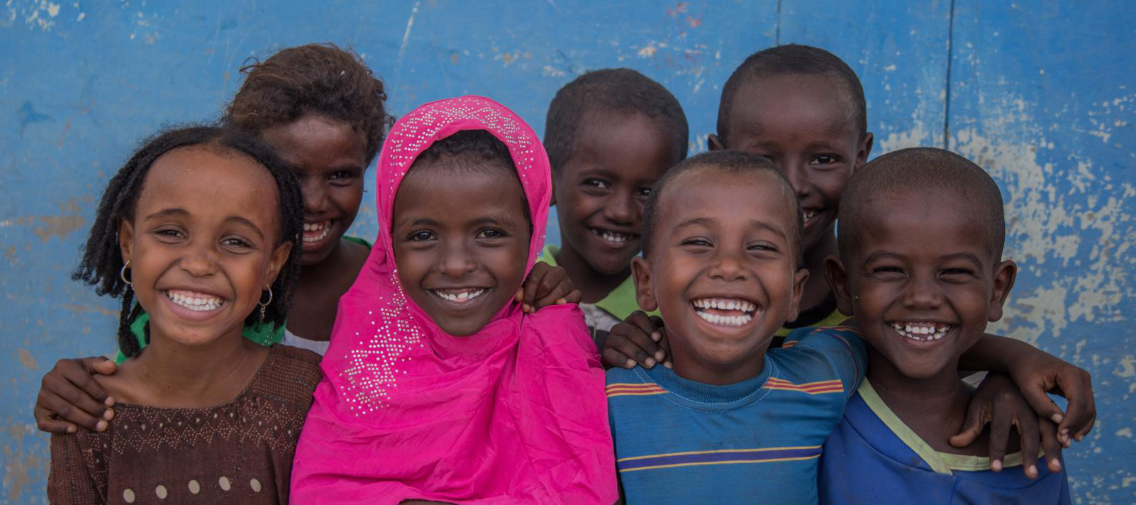 A group of happy children outside the Accelerated School Readiness (ASR) programme at Simbile Primary School, Afar Regional State, Ethiopia on 20 September 2018.